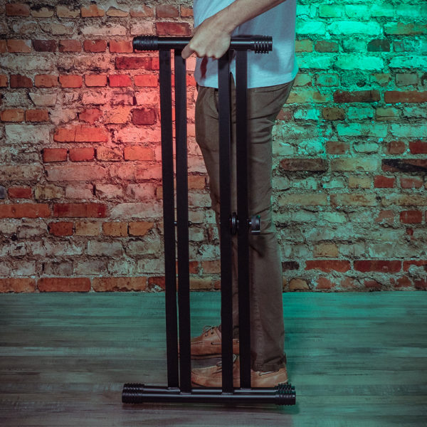keyboard stand shown with man holding it