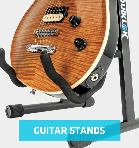 guitar stand holding electric guitar